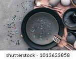 set of grey crockery on table.... | Shutterstock . vector #1013623858