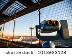 Small photo of coin-operated binoculars or telescope for tourists to observe plane takeoffs and ladings in airport observation deck