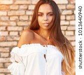sensual portrait of a beautiful ...   Shutterstock . vector #1013640940