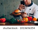 chef man look at beef burger... | Shutterstock . vector #1013656354