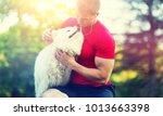 Stock photo man with dog 1013663398