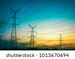 sun setting behind the... | Shutterstock . vector #1013670694