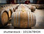 wine barrels in the cellar of... | Shutterstock . vector #1013678434