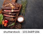 grilled ribeye beef steak with... | Shutterstock . vector #1013689186