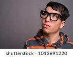 studio shot of young asian nerd ... | Shutterstock . vector #1013691220