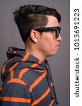studio shot of young asian nerd ... | Shutterstock . vector #1013691223