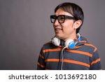 studio shot of young asian nerd ... | Shutterstock . vector #1013692180