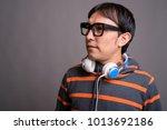 studio shot of young asian nerd ... | Shutterstock . vector #1013692186