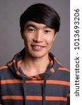 studio shot of young asian man... | Shutterstock . vector #1013693206