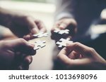 hand holding jigsaw puzzles ... | Shutterstock . vector #1013698096