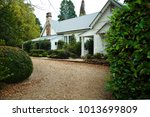 charming white cottage house... | Shutterstock . vector #1013699809