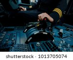 captain hand accelerating on... | Shutterstock . vector #1013705074