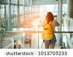 young woman pulling suitcase in ...   Shutterstock . vector #1013705233