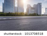 empty road with modern business ... | Shutterstock . vector #1013708518