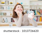woman of the smile having an... | Shutterstock . vector #1013726620