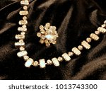 shiny diamond jewelry on black... | Shutterstock . vector #1013743300