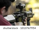 shooter aiming assault rifle at ... | Shutterstock . vector #1013767954