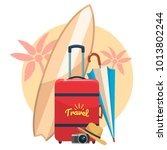 tourist suitcase  camera and... | Shutterstock .eps vector #1013802244