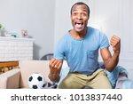 football match. joyful nice... | Shutterstock . vector #1013837440