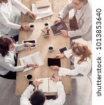 close working table with workers | Shutterstock . vector #1013853640