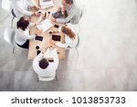 top view in office while people ... | Shutterstock . vector #1013853733