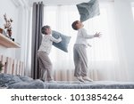 happy kids playing in white... | Shutterstock . vector #1013854264
