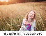 adorable little girl hugs in... | Shutterstock . vector #1013864350