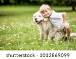 Stock photo happy boy and dog together as friends as love of animals concept 1013869099