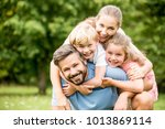 happy family with chlildren... | Shutterstock . vector #1013869114