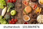 unhealthy or healthy food | Shutterstock . vector #1013869876