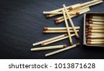 matches in box  dark background....   Shutterstock . vector #1013871628