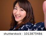 studio shot of mature beautiful ... | Shutterstock . vector #1013875486