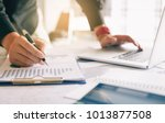 businessman holding pen and... | Shutterstock . vector #1013877508