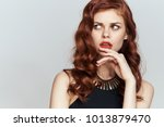 young woman in a beautiful... | Shutterstock . vector #1013879470