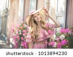 beautiful young woman is...   Shutterstock . vector #1013894230