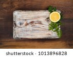 old cutting board with lemon... | Shutterstock . vector #1013896828
