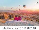hot air balloon flying over... | Shutterstock . vector #1013900140