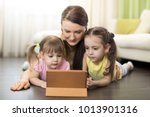 happy mother and kids daughters ... | Shutterstock . vector #1013901316