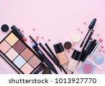 makeup brush and decorative... | Shutterstock . vector #1013927770