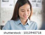 asian businesswoman looking at...   Shutterstock . vector #1013940718