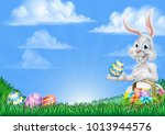 an easter bunny rabbit with... | Shutterstock .eps vector #1013944576