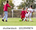 young children players match on ... | Shutterstock . vector #1013949874