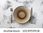 round plate with utensils on... | Shutterstock . vector #1013953918
