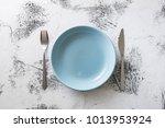 blue round plate with utensils... | Shutterstock . vector #1013953924
