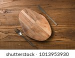 oval cutting board with knife... | Shutterstock . vector #1013953930