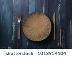 round plate with utensils on... | Shutterstock . vector #1013954104
