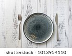 round plate with utensils on... | Shutterstock . vector #1013954110