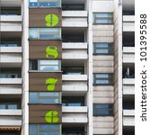 block of flats with numbers for the floors - stock photo