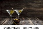 martini with olives. on a... | Shutterstock . vector #1013958889