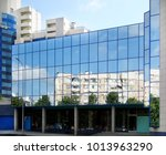 city reflection in mirrored... | Shutterstock . vector #1013963290